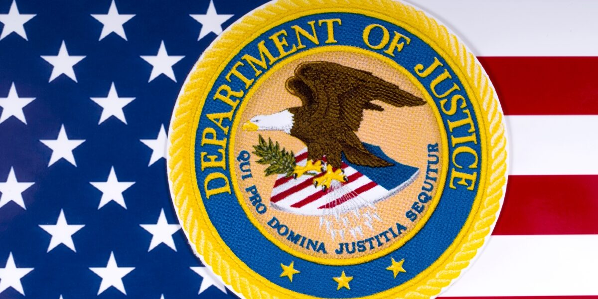 Department of Justice Logo over American Flag - 1200 x 801
